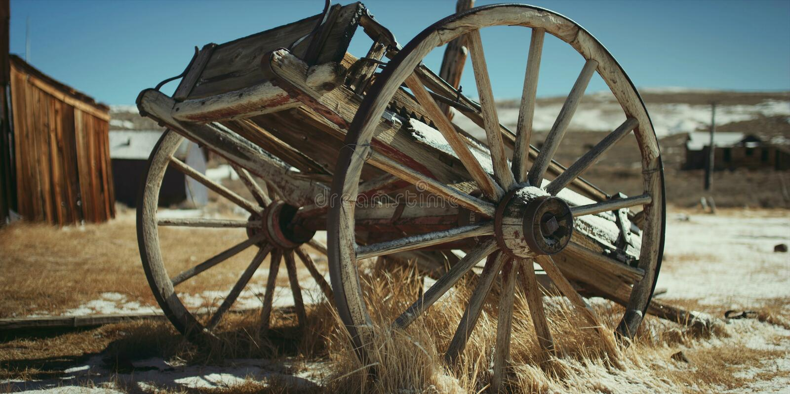 The remains of an old wooden cart close-up royalty free stock image