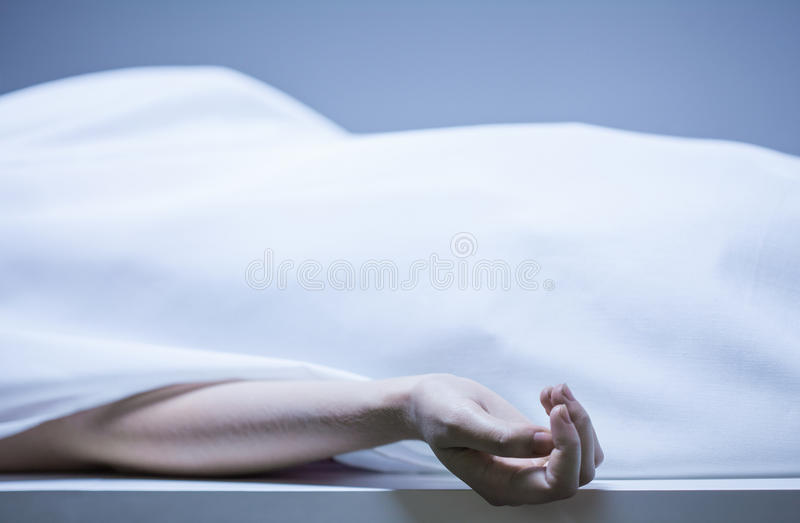 Remains of person in morgue. Remains of person in the morgue, horizontal stock images