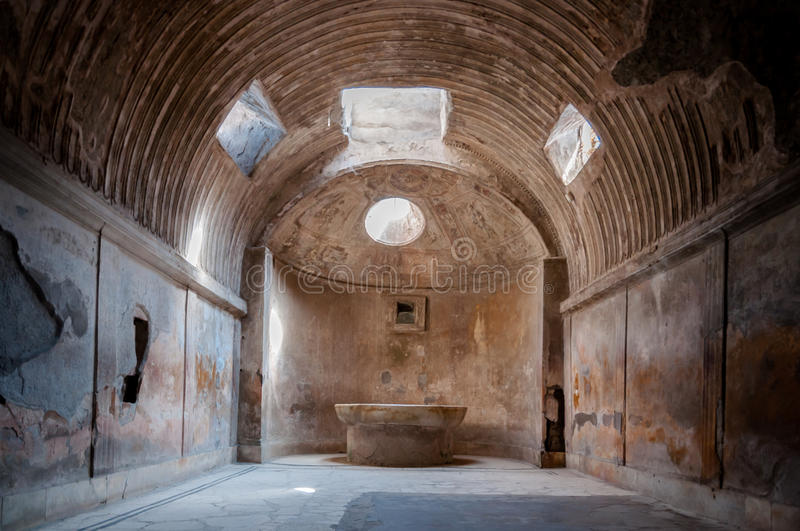 Remains of the public baths in Pompeii . Italy. Remains of the public baths in Pompeii . Pompei was destroyed and buried with ash and pumice after Vesuvius royalty free stock photography