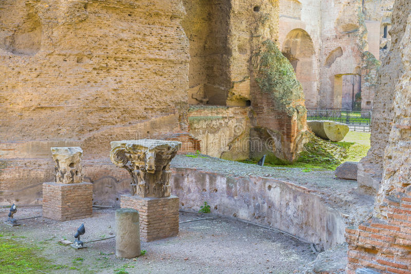 Remains of Roman column ( capitals ) in the ruins of ancient Roman Baths of Caracalla (Thermae Antoninianae) royalty free stock photography