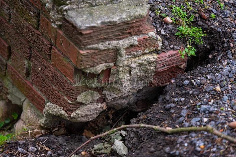 Remains  of a stone bridge on a ditch that slowly forms stock images