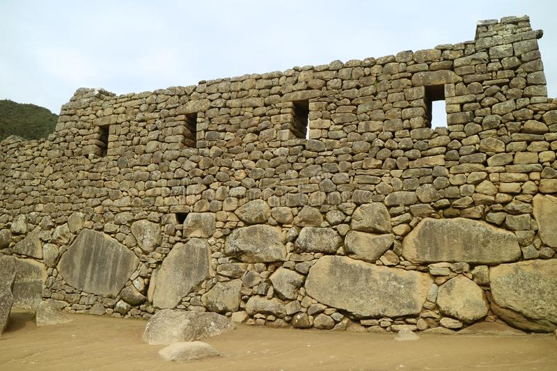 The Remains of Stone Structures in Machu Picchu Citadel, UNESCO World Heritage Site in Cusco Region, Peru. South America royalty free stock image