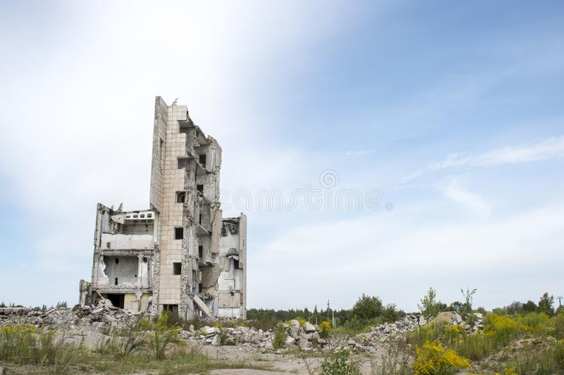 The remains of the structure of a large destroyed building with concrete gray debris around. Background. Text space stock image