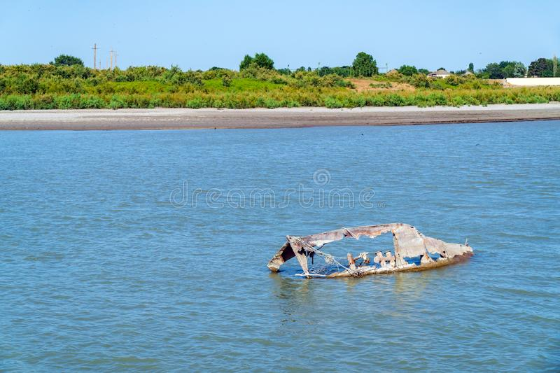 Remains of a sunk fishing boat royalty free stock photos