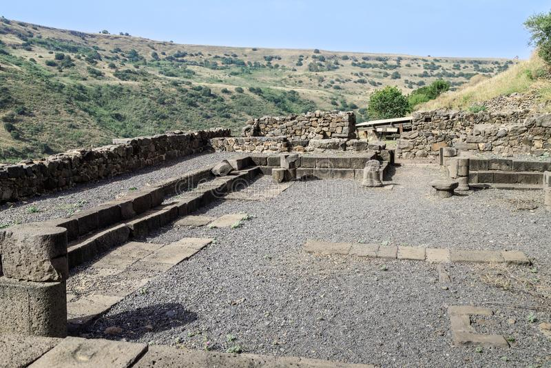 The remains of a synagogue in the ruins of the ancient Jewish city of Gamla on the Golan Heights destroyed by the armies of the Ro. The remains of a synagogue in stock photo