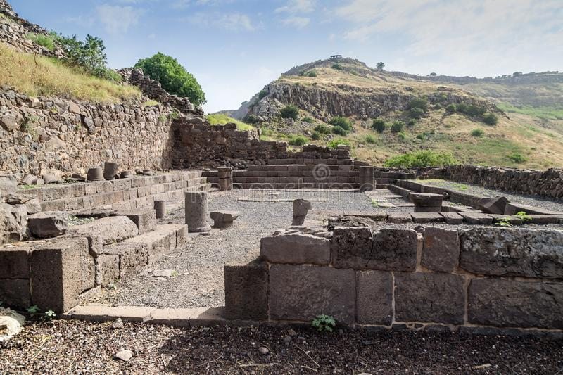 The remains of a synagogue in the ruins of the ancient Jewish city of Gamla on the Golan Heights destroyed by the armies of the Ro. The remains of a synagogue in royalty free stock image