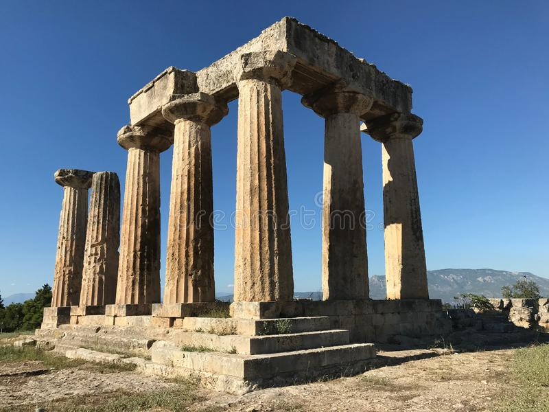 The remains of the temple of Apollo at Ancient Corinth, Greece. The remains of the temple of Apollo at ancient Corinth, Peloponnese, Greece look strong enough to royalty free stock image