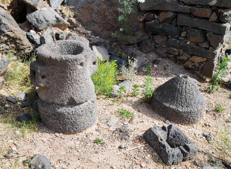 The remains of tools on the ruins of the ancient Jewish city of Gamla on the Golan Heights destroyed by the armies of the Roman Em. The remains of tools on the stock photos