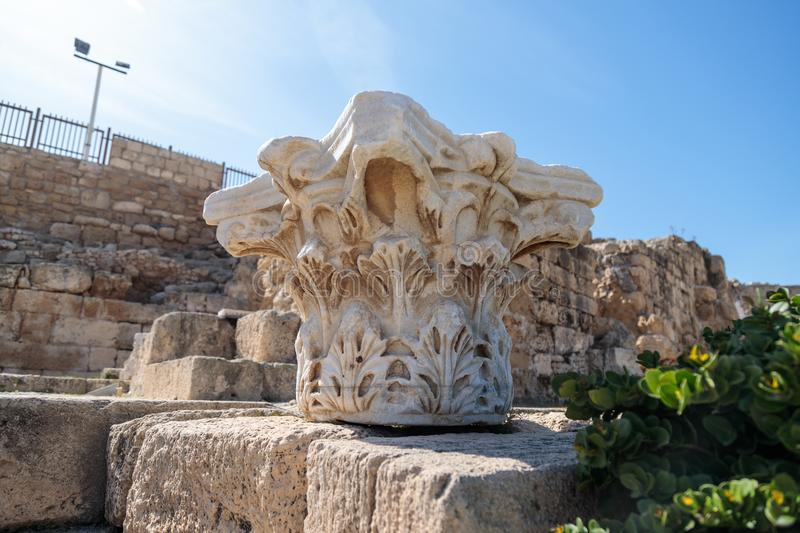 Remains of the upper part of the Roman column of white marble in the ruined city of Caesarea in Israel. stock image