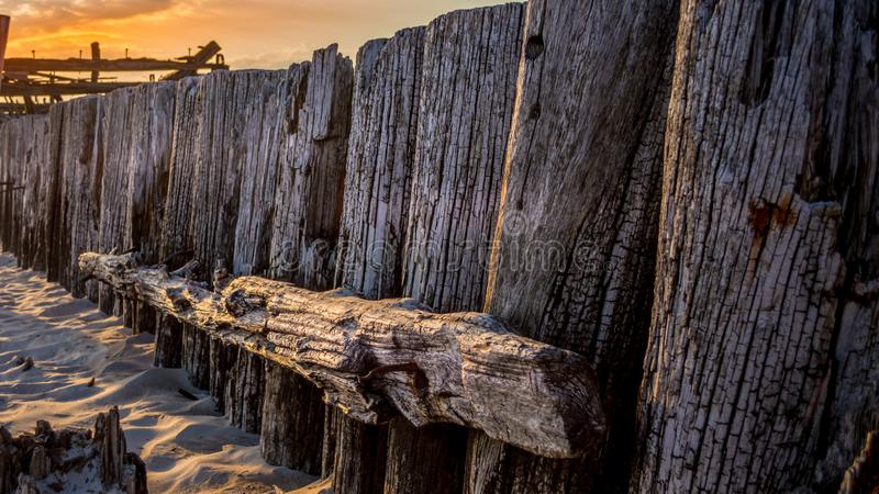Remains of a bridge by the sea royalty free stock image