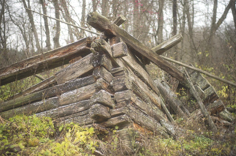 Remains of a wooden house. Ruins of old wooden house close up stock images
