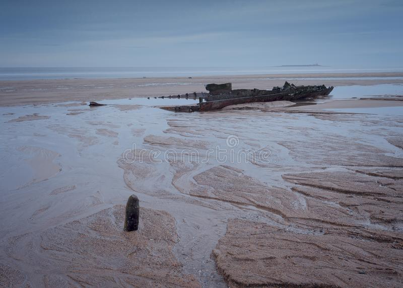 The remains of the wreck of the Hanseat, on Warkworth Beach on the coast of Northumberland. royalty free stock photo