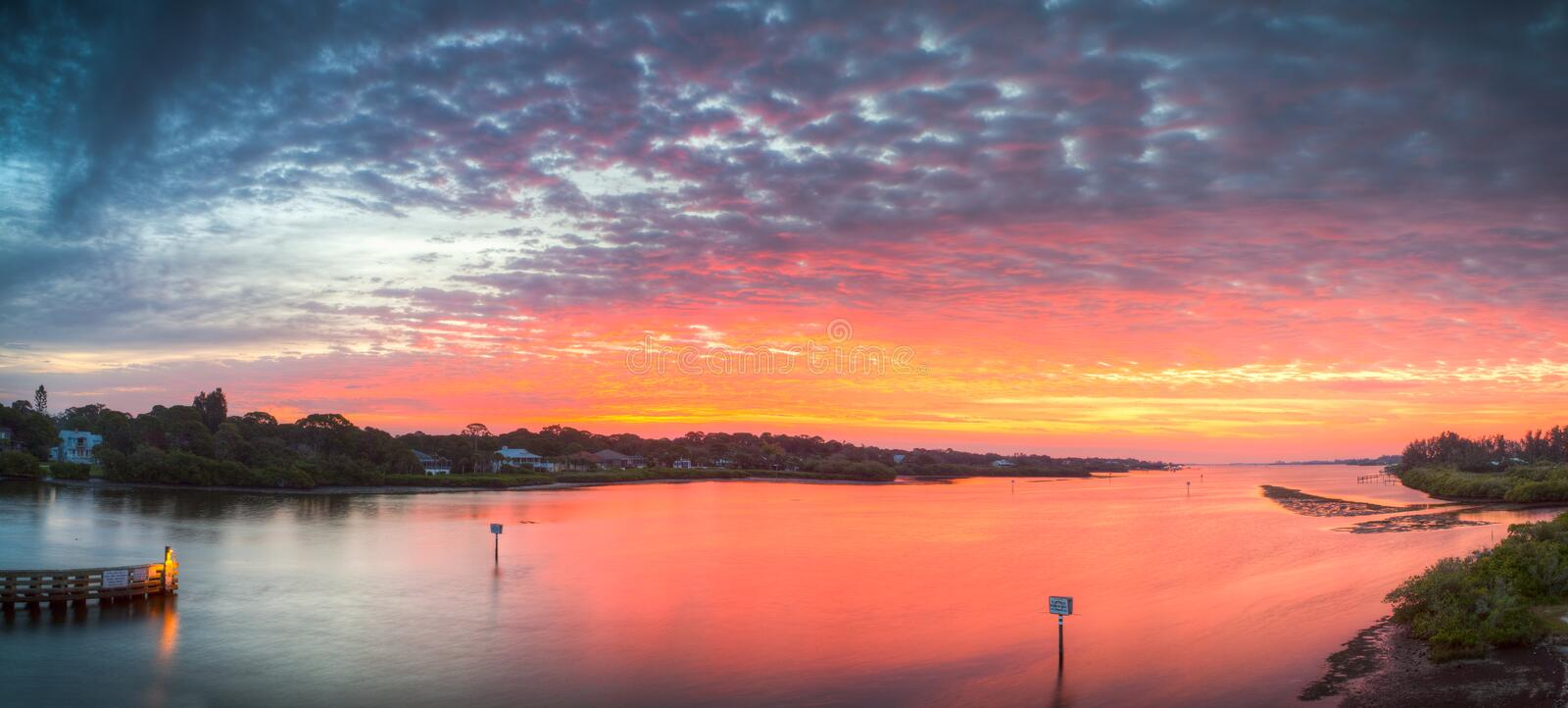 Remarkable colorful sunrise over intercostal in Florida. Remarkable colorful sunrise over intercostal in Englewood,Florida stock images