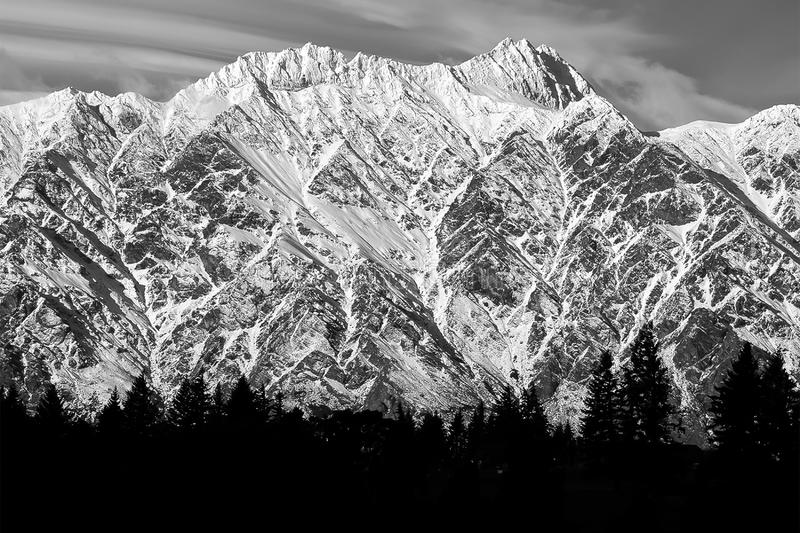 The Remarkables Mountain Range with trees silhouette in black and white in  Queenstown New Zealand royalty free stock images