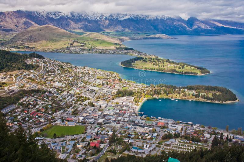 Remarkables mountains behind Wakatipu lake in Queenstown, NZ stock image