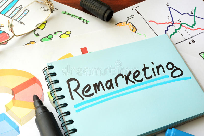 Remarketing written on a notepad sheet. stock photo