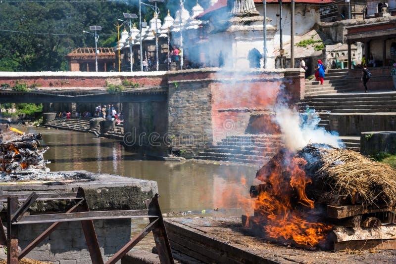 Pashupatinath temple cremations on the Bagmati River. Remation ceremony at Pashupatinath temple on the Bagmati River stock image