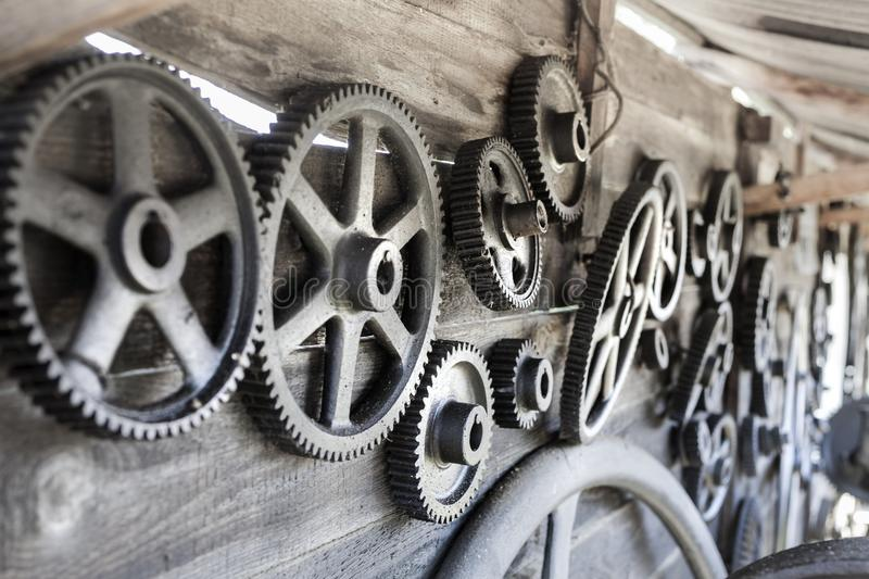 Remember the past: old gearwheels in Romania.  royalty free stock photography