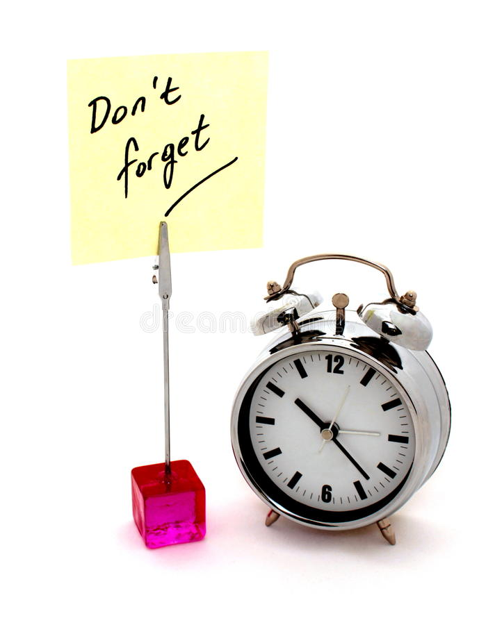 Remember. Yellow note and alarm clock stock photos