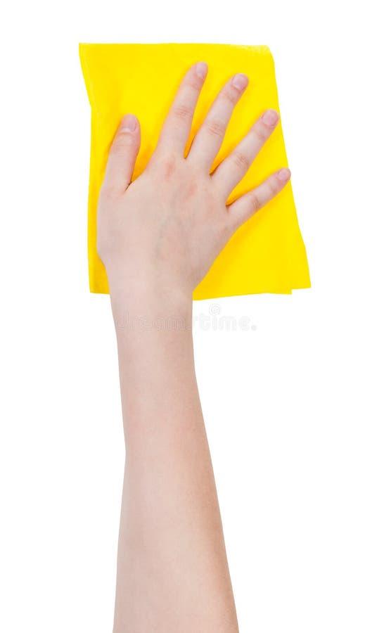 Remettez avec du chiffon de lavage jaune d'isolement sur le blanc images libres de droits