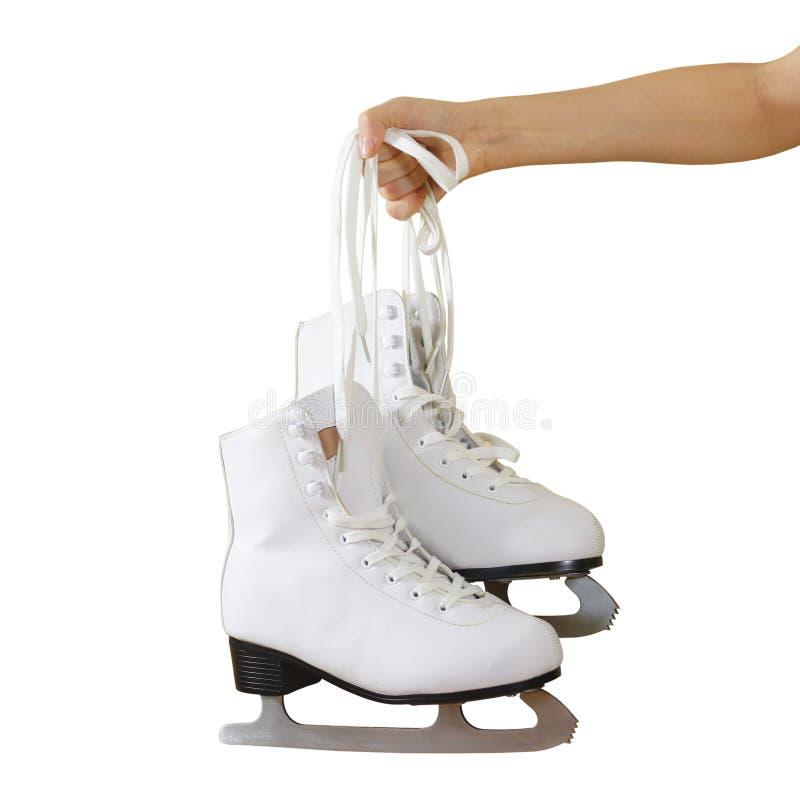 Remettez juger des patins de glace de femme d'isolement sur un fond gris photos stock