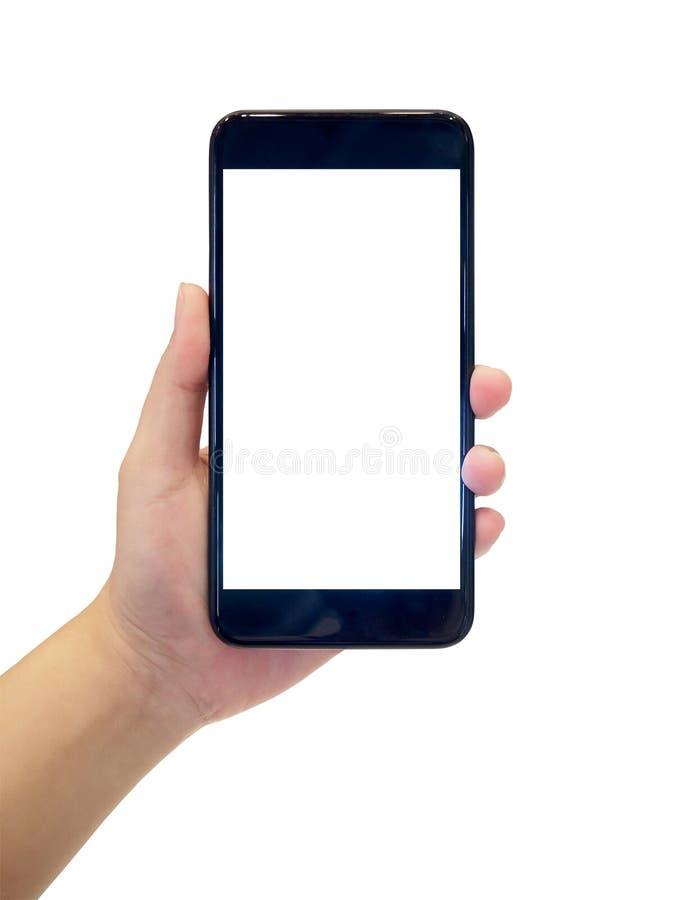 Remettez juger le téléphone intelligent mobile d'isolement sur le blanc photo libre de droits