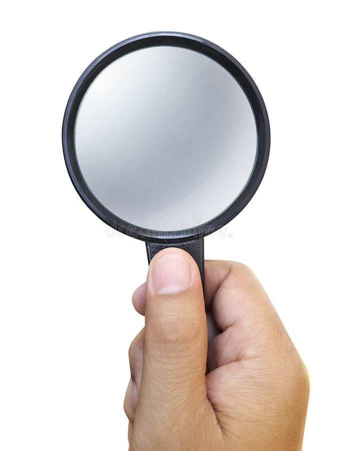 Remettez juger une loupe d'isolement sur un fond blanc photographie stock libre de droits