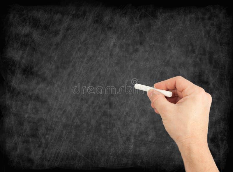 Remettez l'écriture par la craie blanche sur un tableau noir Utile comme backgroun photographie stock libre de droits