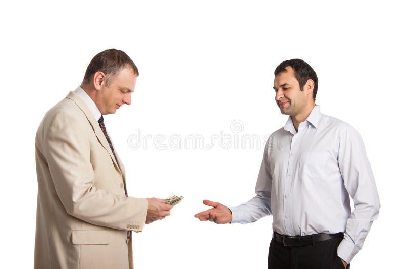 Remettez l'argent l'autre main photographie stock