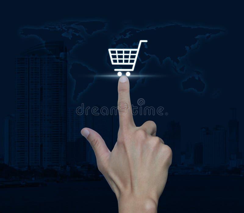 Remettez l'icône de caddie de pressing au-dessus de la tour de carte et de ville, la boutique o photographie stock libre de droits
