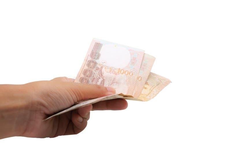 Remettez tenir la devise thaïlandaise, 1000 baht, billet de banque d'argent de la Thaïlande photos libres de droits