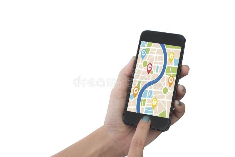 Remettez tenir le téléphone intelligent avec l'application de navigation de généralistes de carte images libres de droits