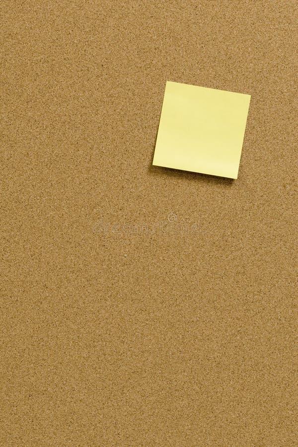 Reminder. Blank post-it note on corkboard stock image