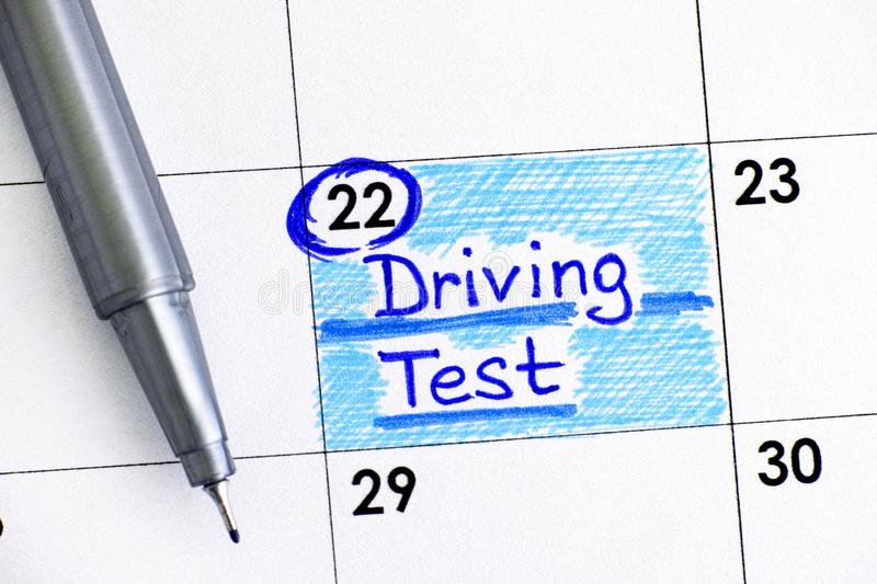 Reminder Driving Test in calendar with pen. Close-up stock images
