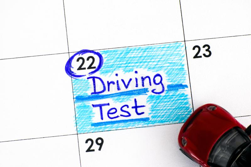 Reminder Driving Test in calendar with red toy car. Close-up stock image