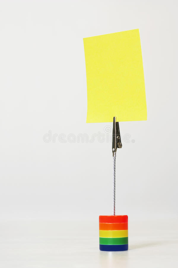 Reminder Holding Yellow Adhesive Note