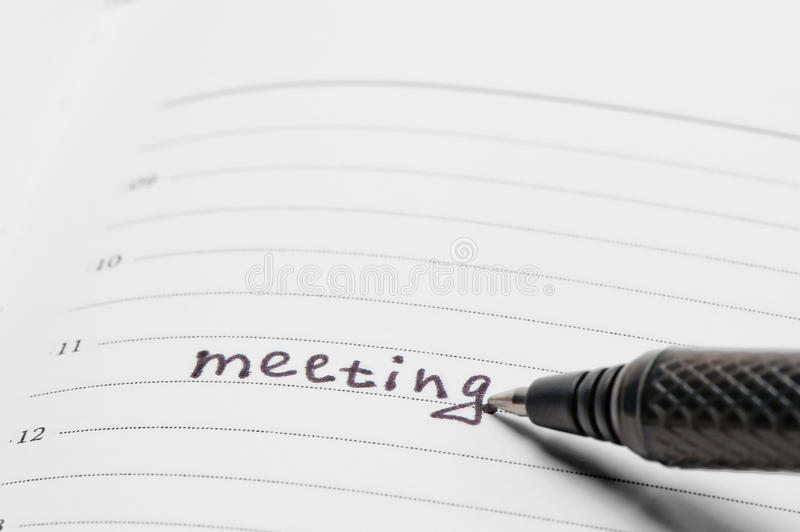 Reminder in the notebook of an important meeting royalty free stock photo