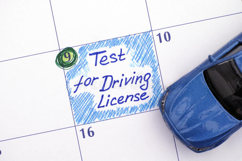 Reminder Test for Driving License in calendar with blue car stock images