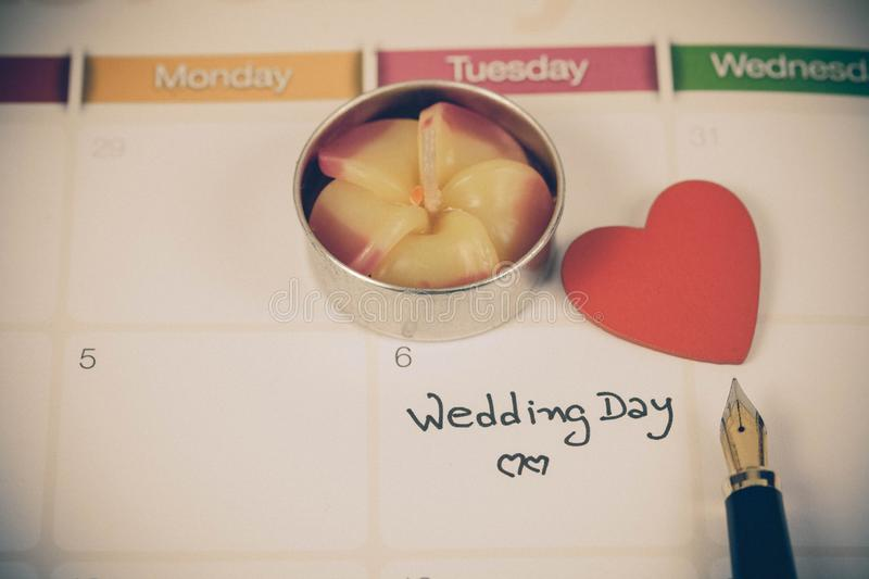 Reminder Wedding day in calendar planning. And fountain stock image