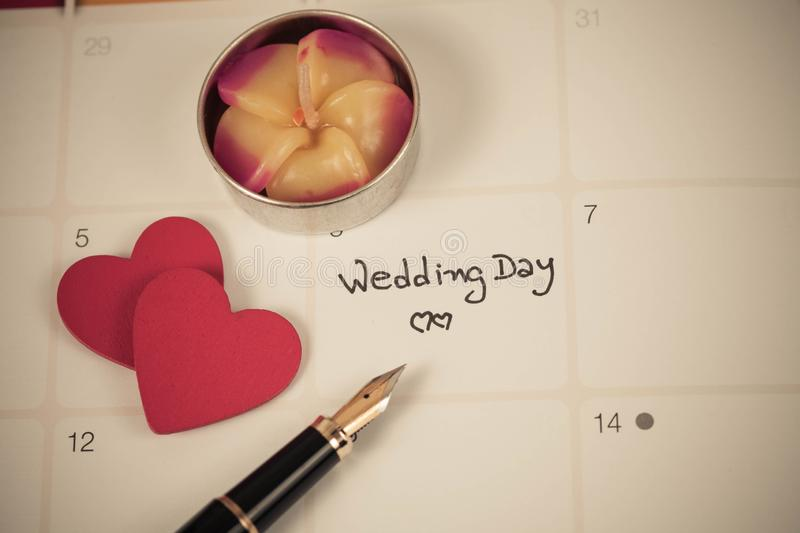 Reminder Wedding day in calendar planning. And fountain stock photos
