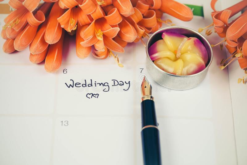 Reminder Wedding day in calendar planning. And fountain stock photo