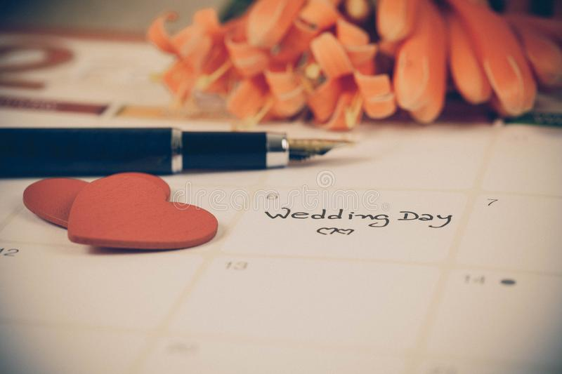 Reminder Wedding day in calendar planning. And fountain stock photography