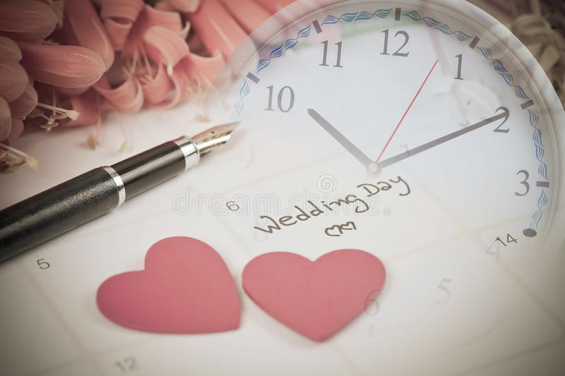 Reminder Wedding day in calendar planning. And clock stock images