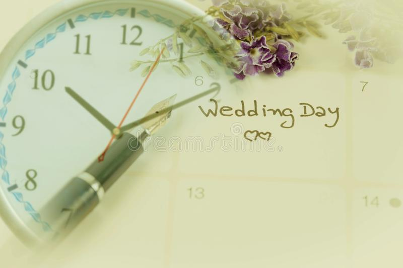 Reminder Wedding day in calendar planning. And clock royalty free stock photo