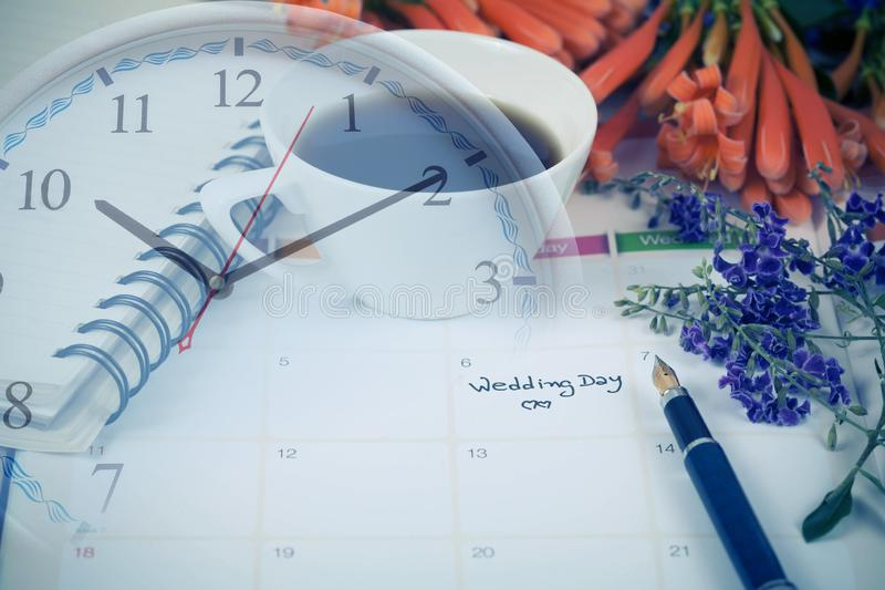 Reminder Wedding day in calendar planning. And clock stock image