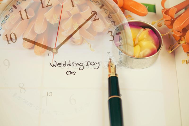 Reminder Wedding day in calendar planning. And clock royalty free stock photos