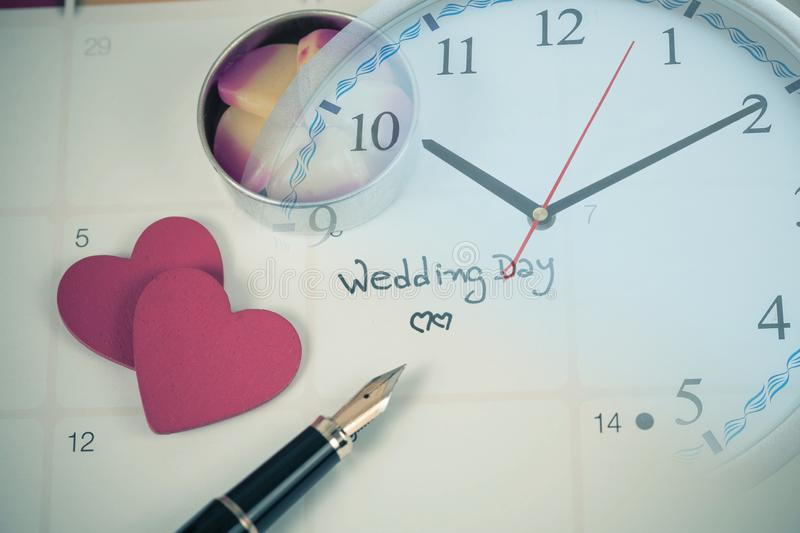 Reminder Wedding day in calendar planning. And clock royalty free stock images
