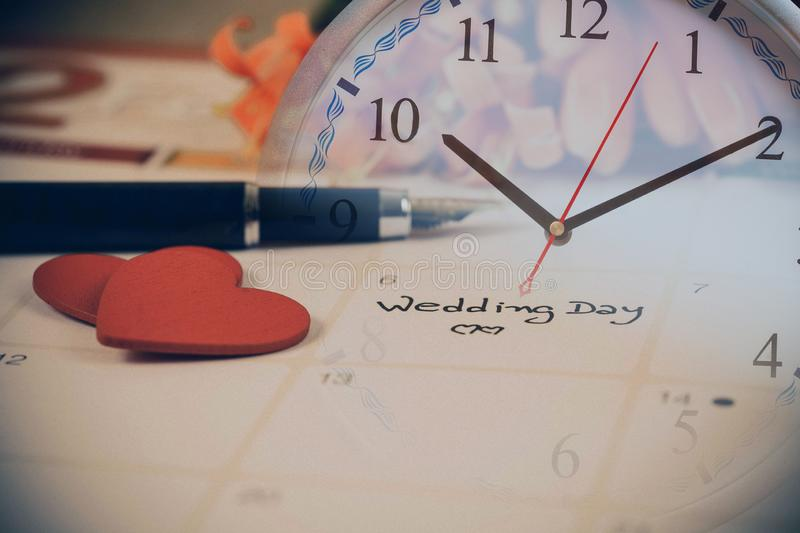 Reminder Wedding day in calendar planning. And clock stock photo