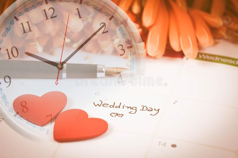 Reminder Wedding day in calendar planning. And clock royalty free stock image