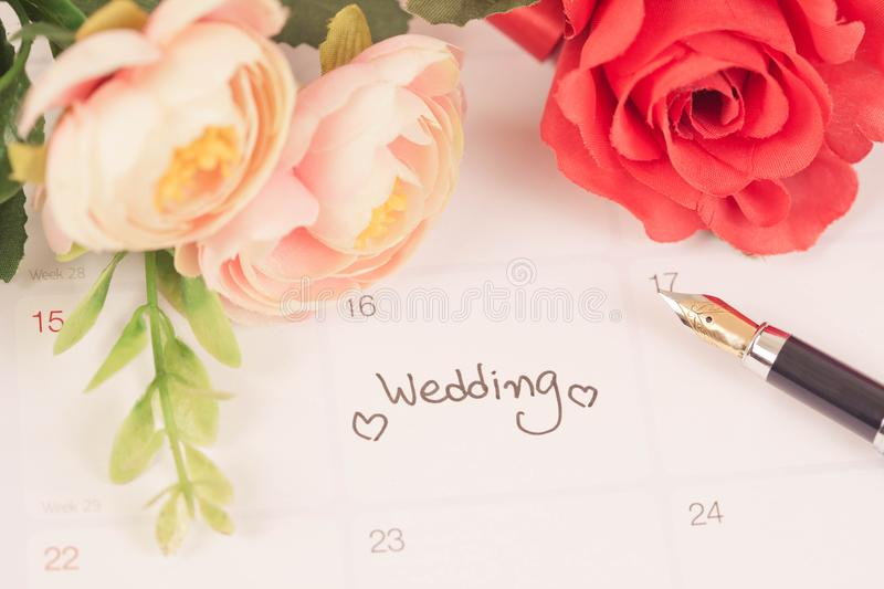 Reminder Wedding day in calendar planning. And fountain pen with color tone royalty free stock photos